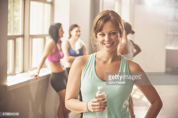 woman smiling in gym - incidental people stock pictures, royalty-free photos & images