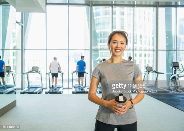 Woman smiling in gymnasium