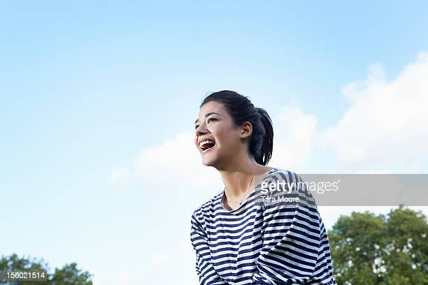 woman smiling in park - 黒髪 ストックフォトと画像