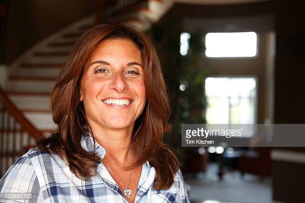 Woman smiling in suburban home, portrait