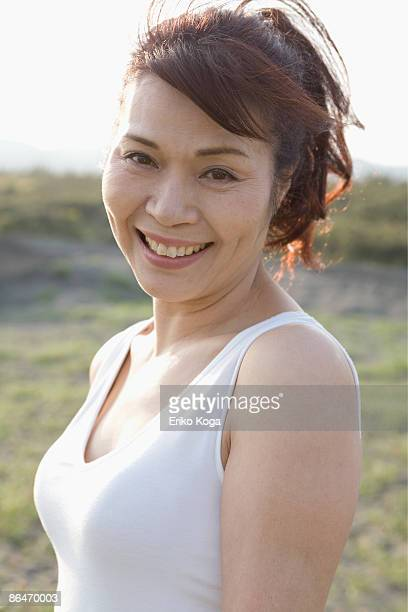Woman smiling in sunlight.