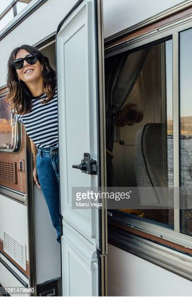 woman smiling inside a campervan wearing sunglasses - stock photo - travelstock44 stock pictures, royalty-free photos & images