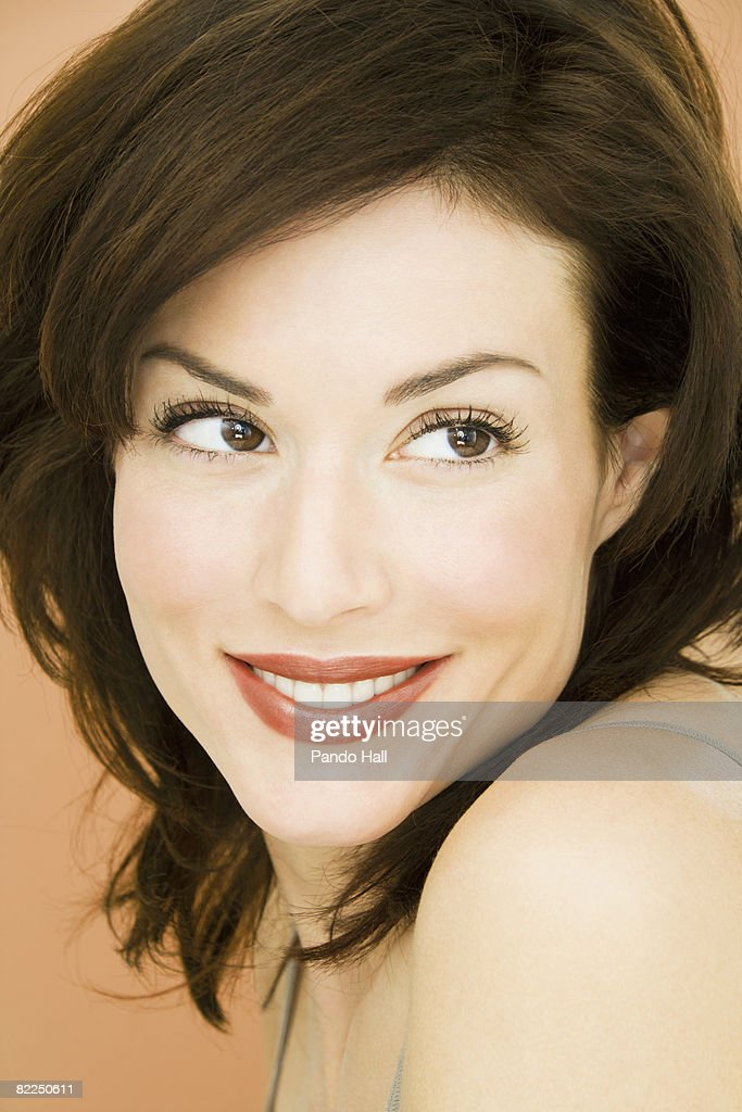 Woman smiling, looking to side, portrait : Stock Photo