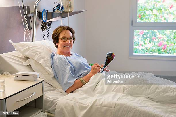Woman smiling on hospital bed