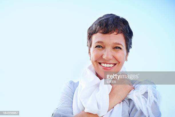 Woman smiling outdoors