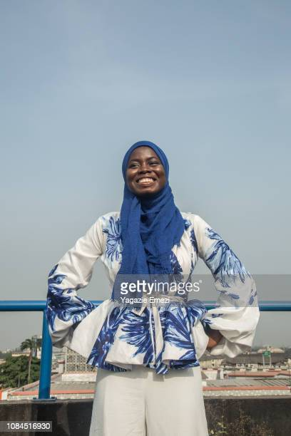 a woman smiling - nigeria stock pictures, royalty-free photos & images