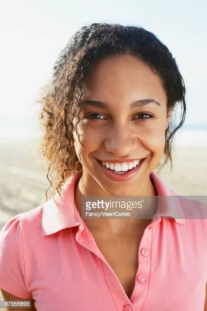 woman smiling - paardenstaart haar naar achteren stockfoto's en -beelden