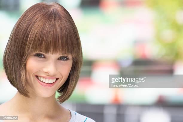 woman smiling - bob frisur stock-fotos und bilder
