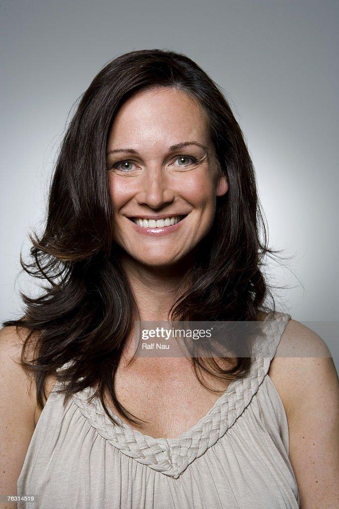 Woman smiling, portrait, close-up : Bildbanksbilder