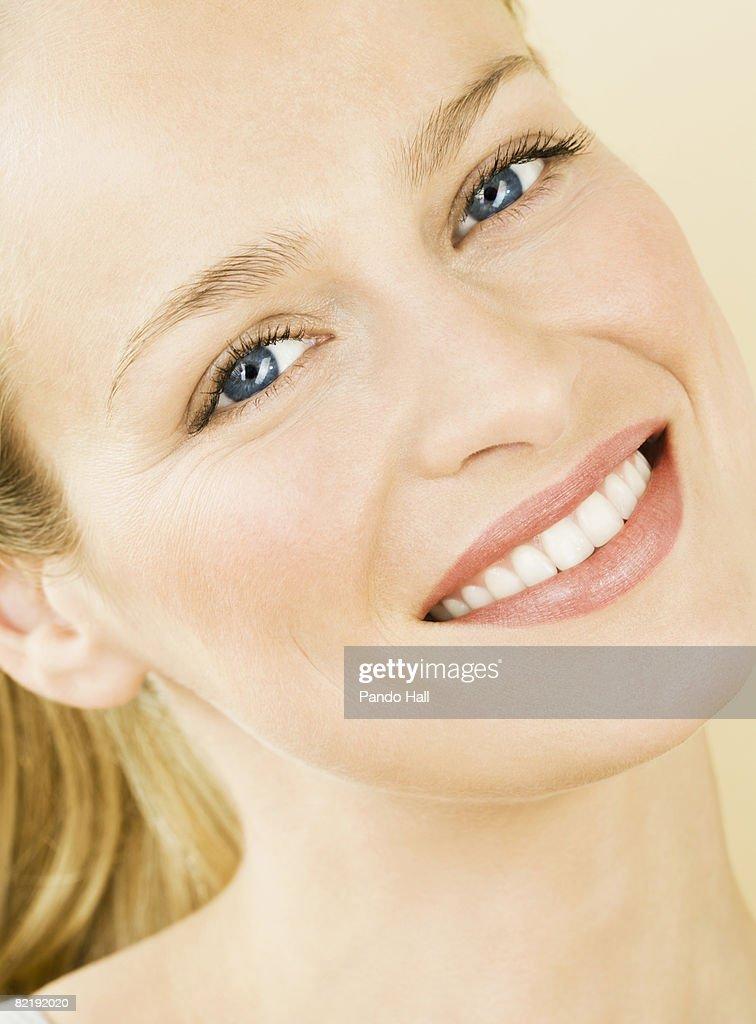 Woman smiling, portrait : Stock Photo