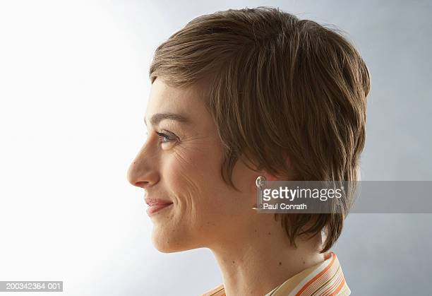 Woman smiling, side view