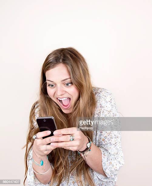 Woman smiling using phone