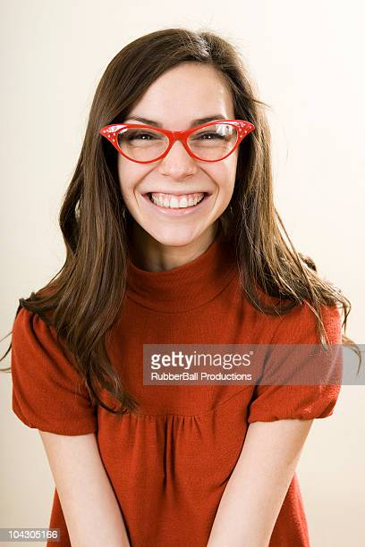 woman smiling wearing horn rimmed glasses - nerd stock pictures, royalty-free photos & images