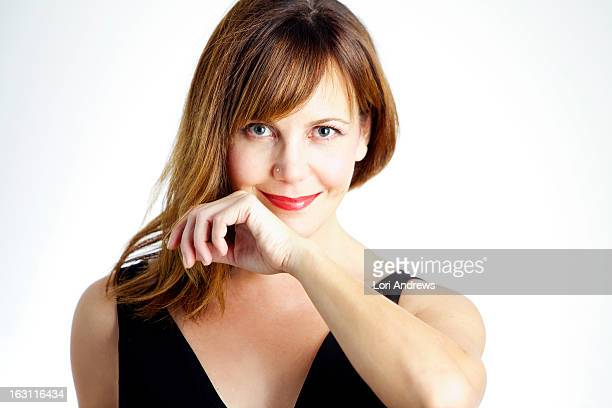 Woman smiling with brown hair & red lips