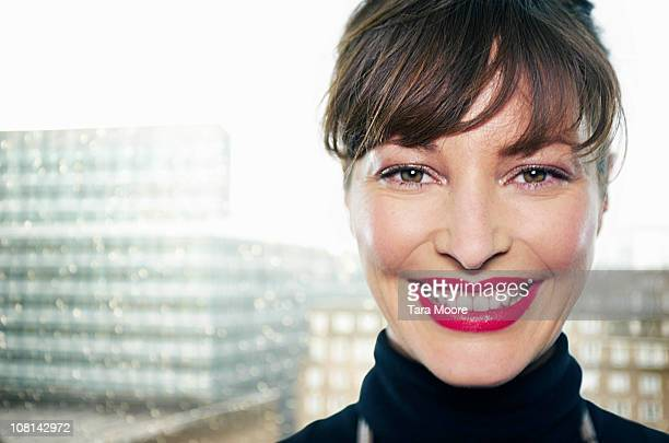 woman smiling with city background