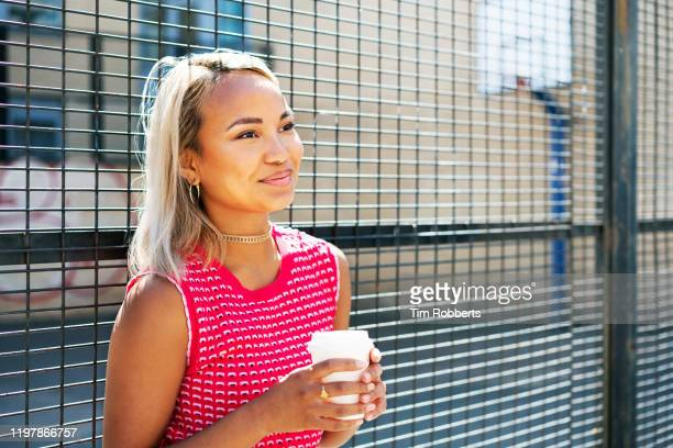 woman smiling with coffee cup - piercing stock pictures, royalty-free photos & images