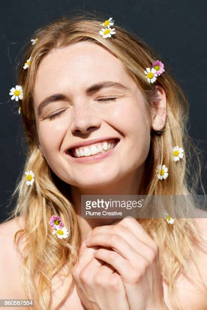 Woman smiling with daisies in hair