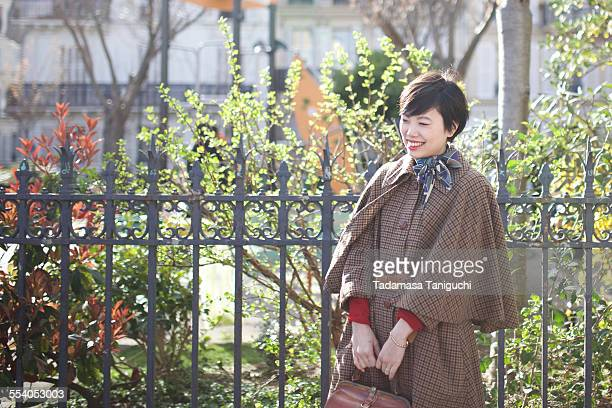 Woman smiling with her favorite fashion