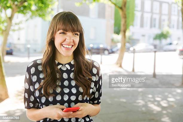 Woman smiling with smart phone