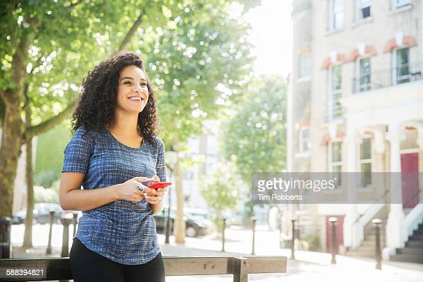 Woman smiling with smart phone.