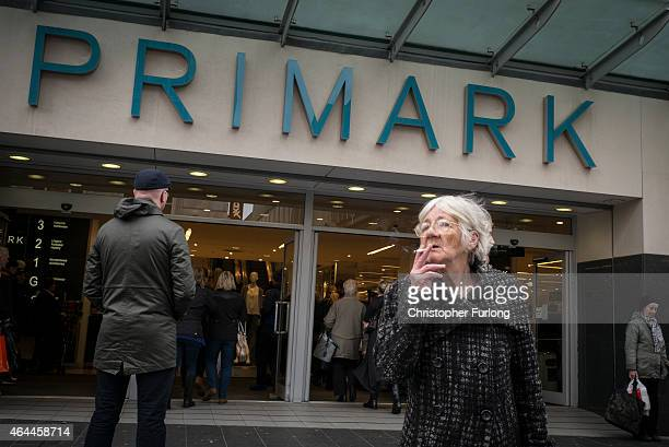 A woman smokes a cigarette outside the Primark store in Liverpool city centre on February 20 2015 in Liverpool United Kingdom As the United Kingdom...