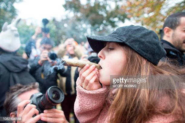 A woman smokes a marijuana cigarette during a legalization party at Trinity Bellwoods Park in Toronto Ontario October 17 2018 Nearly a century of...