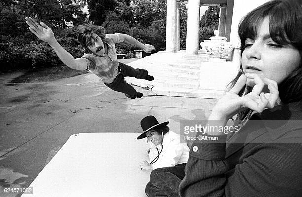 A woman smokes joint while a man tests the newly invented waterbed by Chetana Dr Hip September 1971 in Berkeley California
