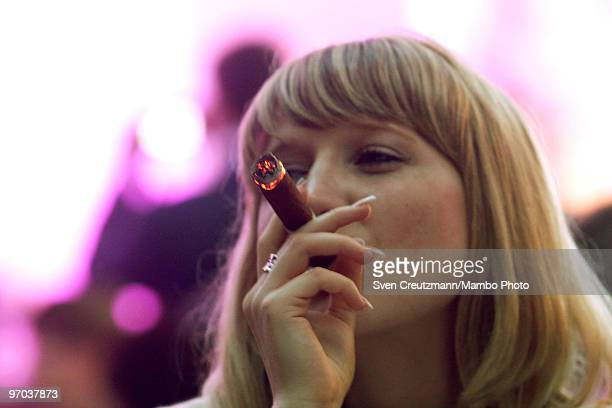 A woman smokes the new 'Julieta' cigar on February 24 in Havana Cuba In response to cigar sales lagging Cuba is trying to interest women smokers in...