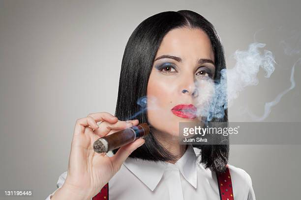 woman smoking a cigar, portrait - beautiful dominant women stock pictures, royalty-free photos & images