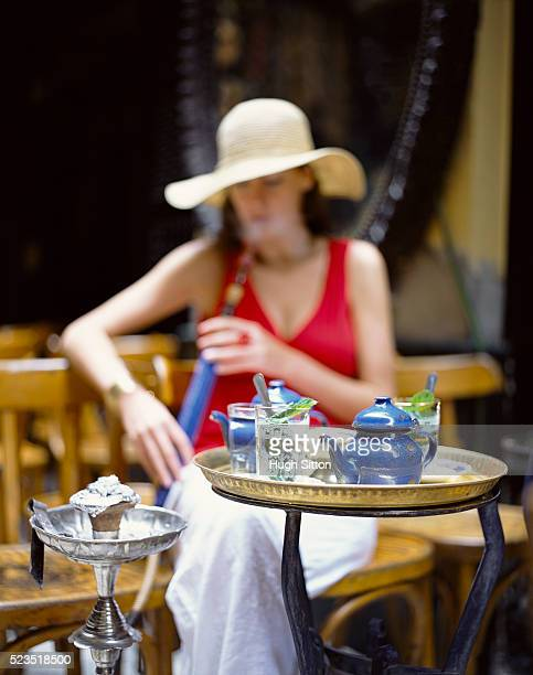 woman smoking a hookah - hugh sitton stock pictures, royalty-free photos & images