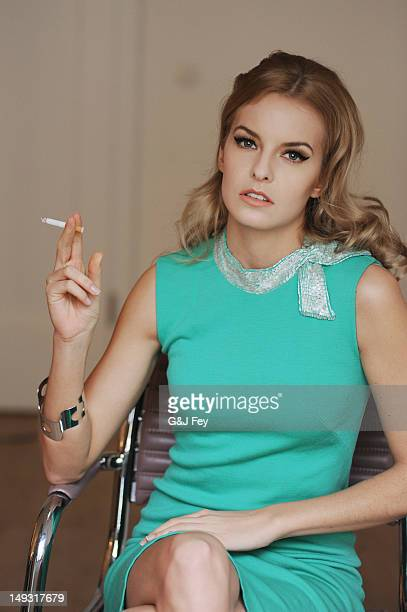Woman smoking cigarette in armchair