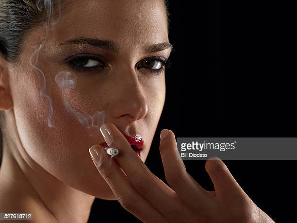 woman smoking cigarette - beautiful women smoking cigarettes stock photos and pictures