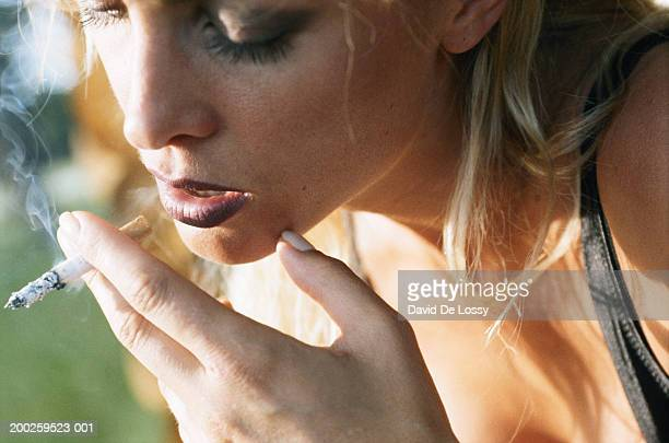 Woman smoking, close up