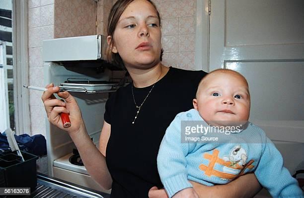 Woman smoking near baby