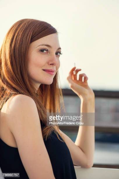 Woman smoking, portrait