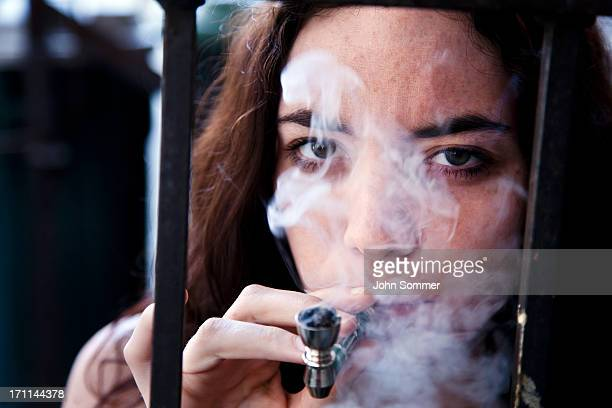 woman smoking pot - drug abuse stock pictures, royalty-free photos & images