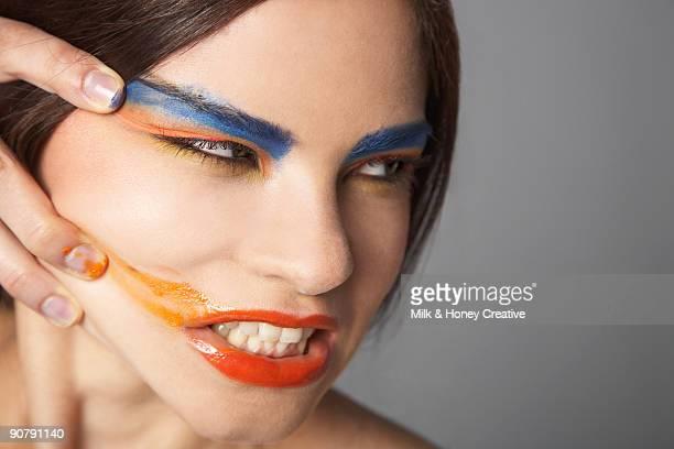 Woman smudging make up