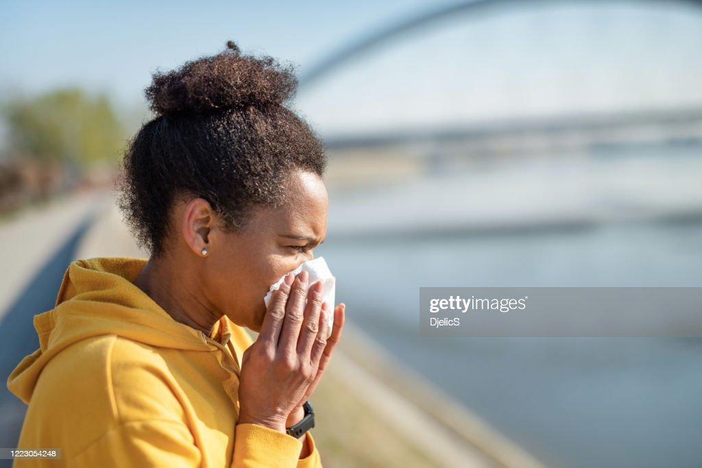 Woman sneezing. : Stock Photo