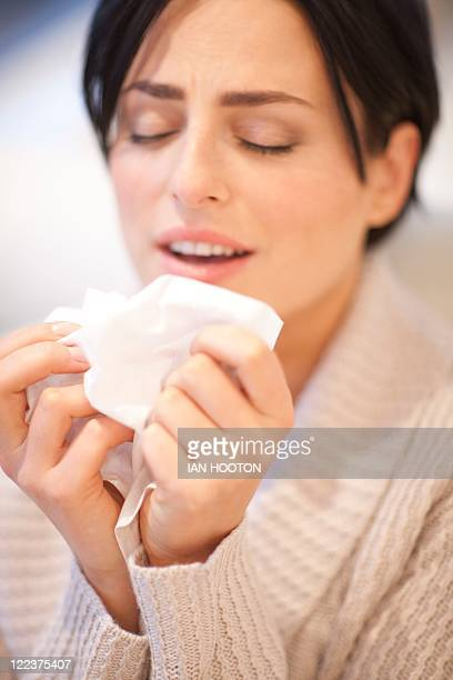 woman sneezing - respiratory disease stock pictures, royalty-free photos & images