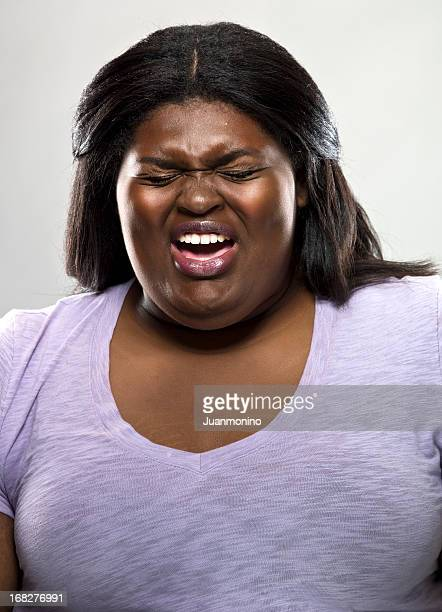 woman sneezing - images of fat black women stock photos and pictures