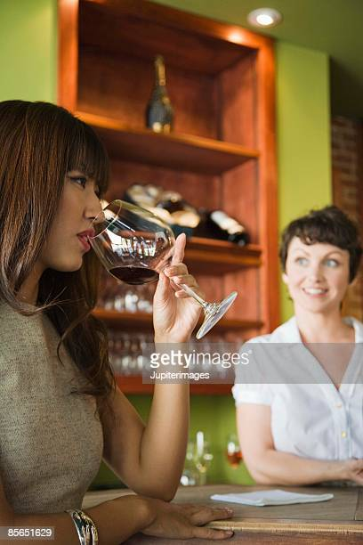 Woman sniffing wine in wine bar