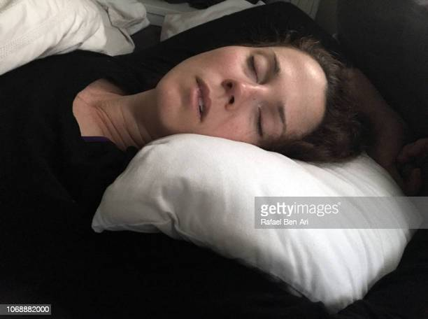 Woman Snoring in Bed