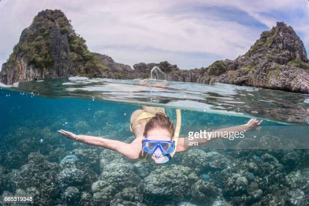 Woman snorkeling by an Island, Double Perspective Dome