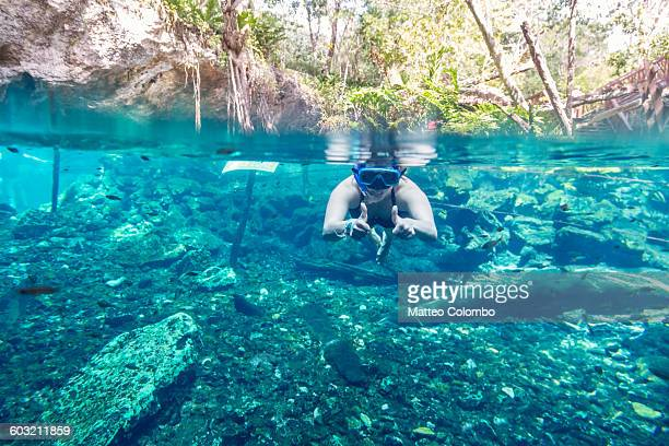 Woman snorkeling in a cenote, Mexico