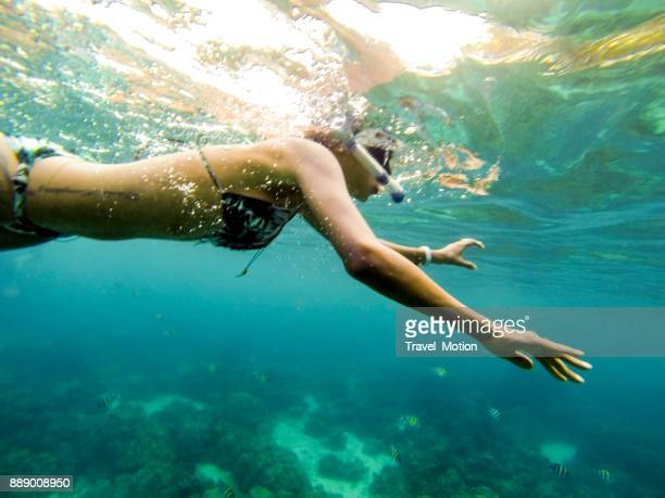 Woman snorkeling in Phuket, Thailand