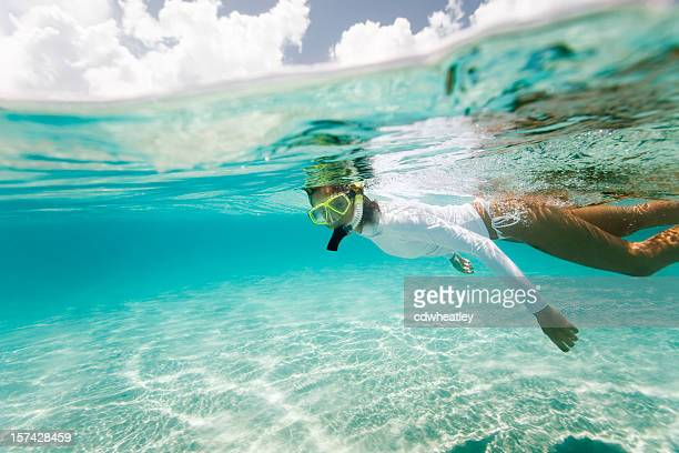 woman snorkeling in the caribbean - snorkeling stock pictures, royalty-free photos & images