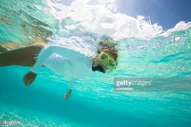 woman snorkeling in the Caribbean