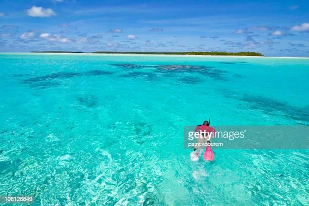 A woman snorkeling in the reefs