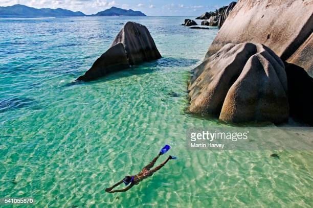 woman snorkeling - la digue island stock pictures, royalty-free photos & images