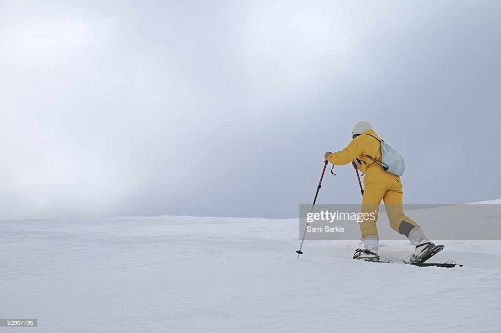 Woman snowshoeing, French Alps, France : Stock Photo